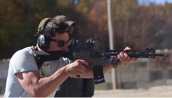 Jeff Bloovman fires a rifle